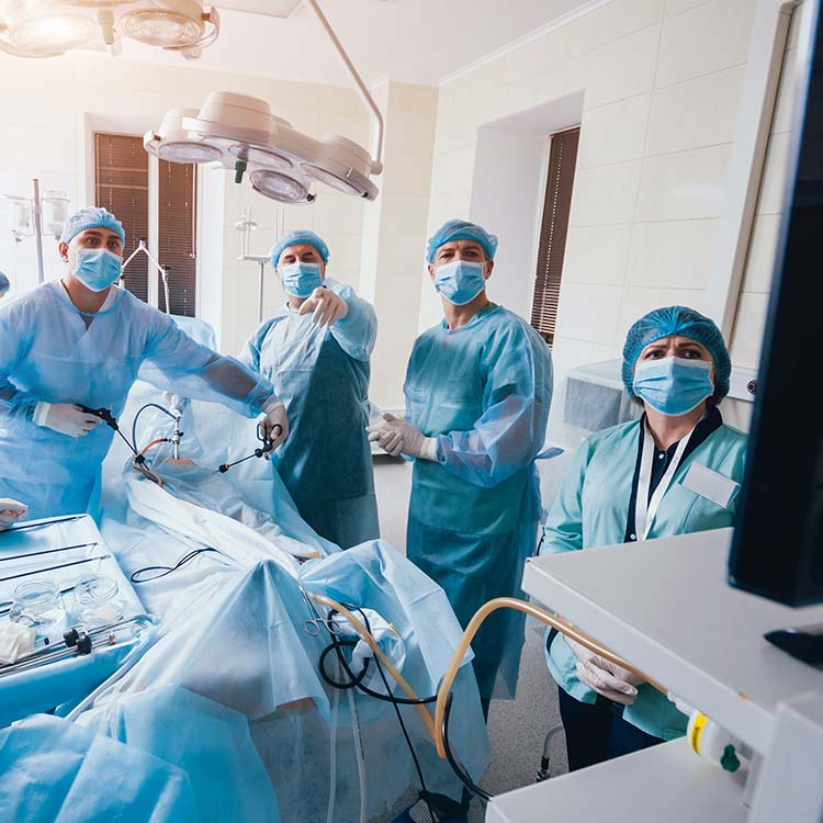 Surgeons using a scope during a procedure